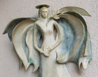 Holiday gift guide .Flaying angel, Hanging on the wall sculpture. Christmas decoration, Holiday decor.