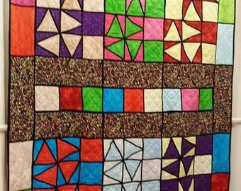 Quilt - Multi-colored stars and pinwheels, squares and triangles- A Wonderful View - 56 in. x 79 in.