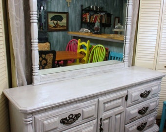 Sold this item is sold  9 drawer OSSOW dresser server buffet changing table all wood like new condition with mirror