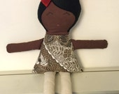 Rag doll, recycled fabrics, brown and white print, red bow and black washable felt hair.