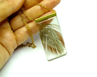 Feather pendant. Plume Resin jewelry. Modern jewelry. Brown and brass. Gold. Feather resin pendant