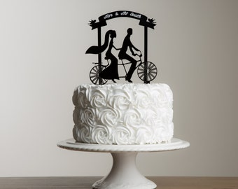 Bride and Groom tandem bike and banner personalised cake topper.