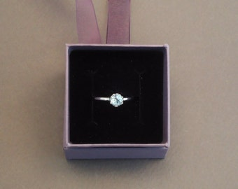 Silver ring with a blue topaz