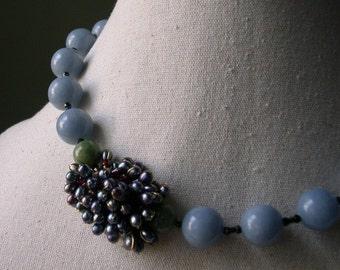 FRUIT D'HOMME Collier en pierres naturelles (spinelle, hématite, célestite, jade, perle d'eau douce, grenat)