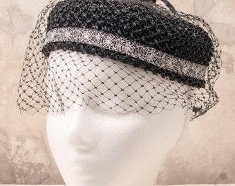 Ladies vintage black velvet halo hat w/webbing, embellished for Halloween.