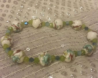 Lovely Stretch Bracelet of Hand Painted Ceramic Round Beads, Shades of Blue Swarovski Crystals and Green Crystals