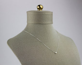 Sterling silver necklace with cube bead