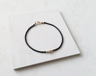 Simple Minimalist Beaded Bracelet on Silk Cord - 14k Gold Filled Round and Black  Glass Beads