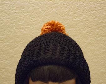 Black hat with gold pompom