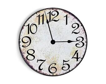 Antique white wall clock.  Circle design.