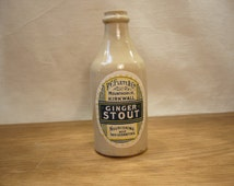Vintage stoneware ginger beer bottle with label for PC Flett's Ginger Stout from Kirkwall in the Orkney Islands