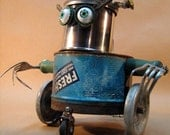 """UPCYCLED Recycled Reused Re purposed  ROBOT Sculpture - """" wheelchair rugby player """" - found objects art,scrap art,renewal,on the wheels"""