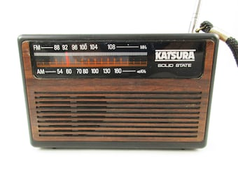 A 1970s 'Katsura Solid State' Portable Radio - Model 207-0100 - Made in Philippines - Antennae and Wrist Strap - Earphone Plug - FM/AM