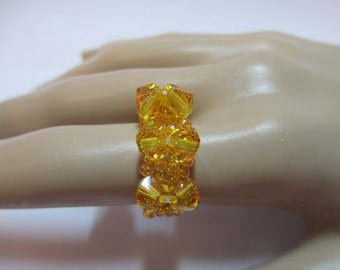 Ring yellow beads with eight 6MM yellow crystals on stretchy cord size is about an 8