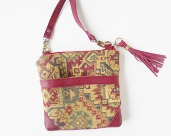 Crossbody bag in tribal tapestry with leather trim.