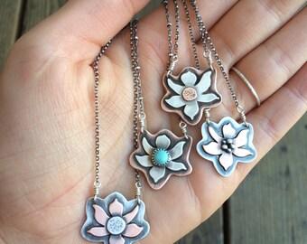silver and copper mini dogwood pendants