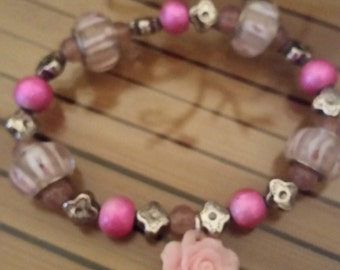 Pink Beaded Bracelet with Flower Accent