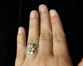 R 215 Sterling silver floral ring approximate size 7