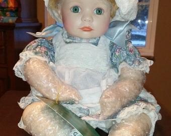 Moment's Treasues Porcelain Head Doll