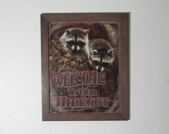 Mounted and Framed Welcome To Our Hideout raccoon tin sign