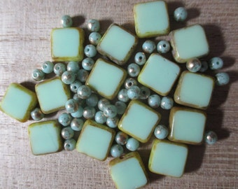 Mix of 10mm square and 4mm round aqua Czech glass beads