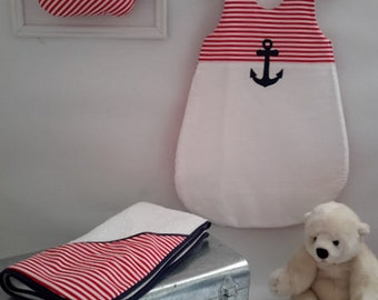 Sleeping bag, turbulette baby was red and white and matching bath cape