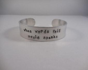 When Words Fail Music Speaks, Hand Stamped Aluminum Cuff Bracelet
