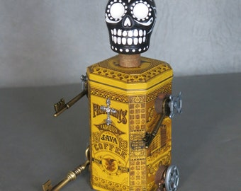 "Day of the Dead sculpture.  One of a kind.  Peruvian sugar skull, coffee tin, found objects.  ""Coffee Strong Enough to Wake the Dead."""