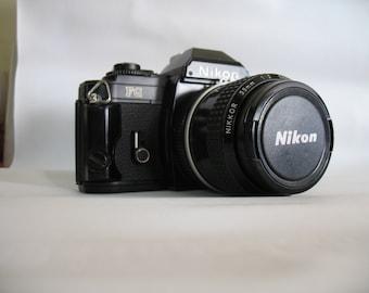Nikon FG Black 35mm SLR Film Camera with Nikon Nikkor 35mm 1:2 Lens