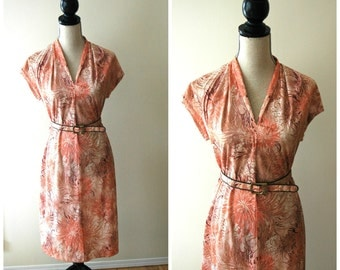 1960's floral day dress with cap sleeve, v neck and belted waist.