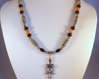 Women's Orange and Black Skeleton Beaded Necklace