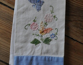 Vintage appliqued and embroidered tea towel