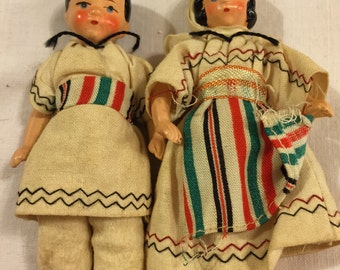 Sweet pair of vintage regionally dressed dolls