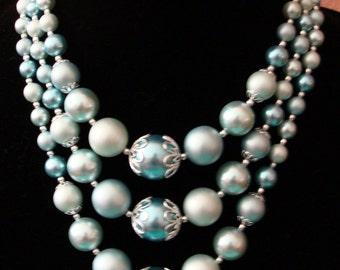 3 strand light aqua plastic beads