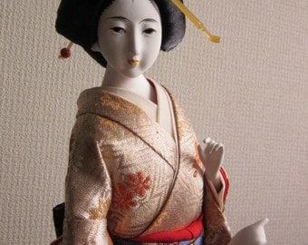 A Japanese doll, geisha girl, dancing girl in kimono, vintage