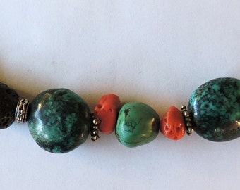 Gemstones necklace: Turquoise, coral and volcanic lava.