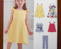 Simplicity - New Look 0996 - Sizes 3-8. Girl's jumper pattern along with top and stretch pants. Pattern is new and uncut.