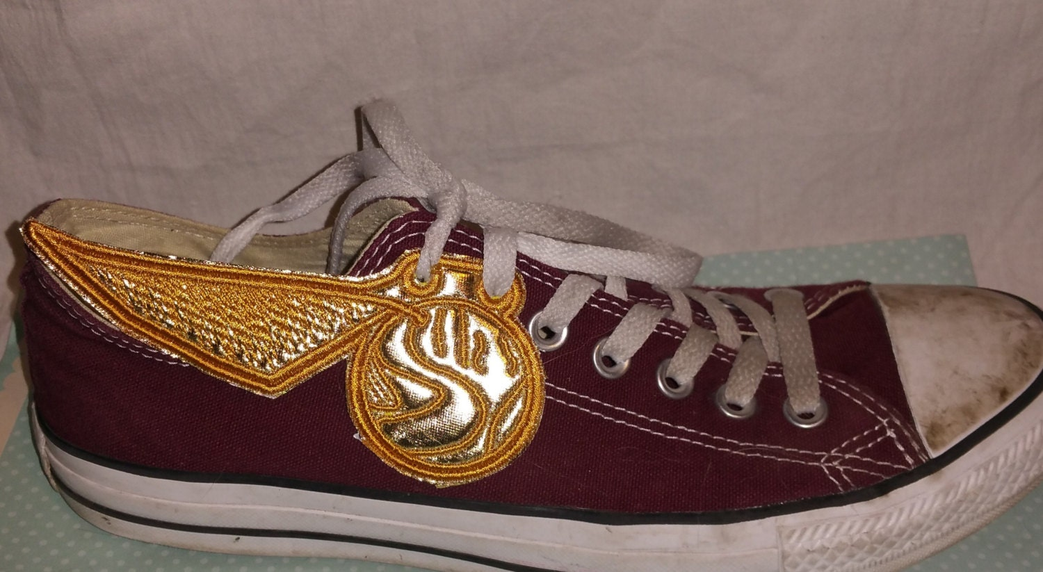 Golden snitch shoe wings in the hoop machine embroidery design