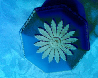 Blue Wedgewood decorated with delicate white tracery
