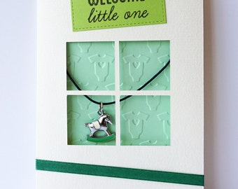 """Handmade Welcome Little One greeting card with green """"rocking horse"""" keepsake jewellery piece"""