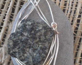 Gray stone with square black speckled stone on top wire wrapped pendant