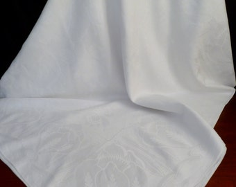 Estate linen damask tablecloth.  Art nouveau pattern of blossoms