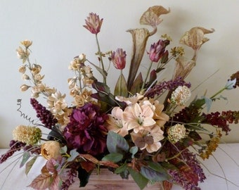 Rustic floral arrangement with meadow and woodland flowers.