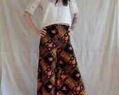 vintage 70s high waisted black bright floral palazzo pants / xs wide leg pants