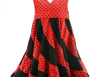 Red with black spots peppermint swirl dress size 4 -5 years