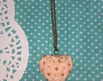 Pendant/Cabochon heart in flowers with Ladybug and gilding