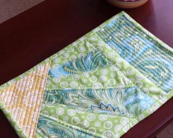 Turquoise, lime green and yellow mug rug
