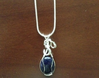 Sterling silver blue goldstone wrapped pendant
