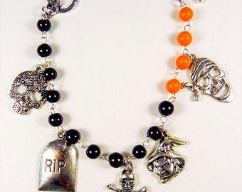 Bracelet, Halloween bracelet, charm bracelet, Halloween jewelry, charm jewelry, black beads, orange beads, skeleton toggle, toggle clasp