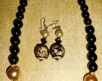 Black Glass Beads with Yellow Pearl and LampWork Center Bead with Earrings